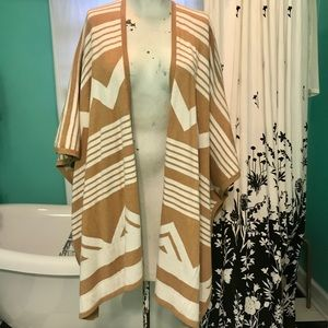 Tan and white cape cardigan poncho.